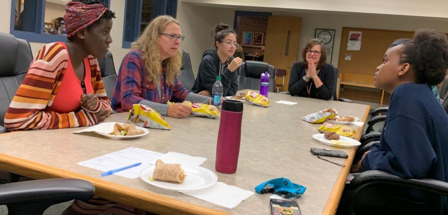From left to right:   Angela Nabakka, A.S. King, Christina Vargas, Anita Cellucci, and Kyla Kamugu have lunch together with author A.S. King.