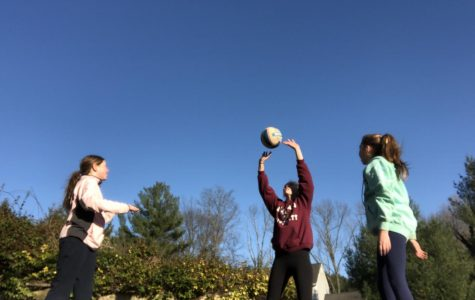 Freshman Shannon Clark and her sisters practice their voilleyball skills during quarantine.
