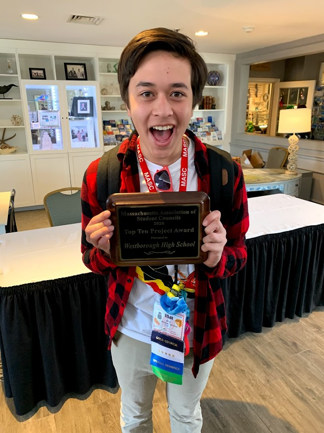 WHS+Senior+Ethan+Chan%2C+Student+Council+President%2C+displays+the+Massachusetts+Student+Council+Top+Ten+Project+Award+for+last+year%27s+Mental+Health+week.