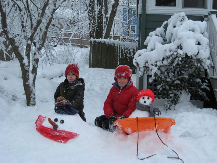 Now senior Sam Schiffman and his older brother Will enjoy a snow day from many years ago.