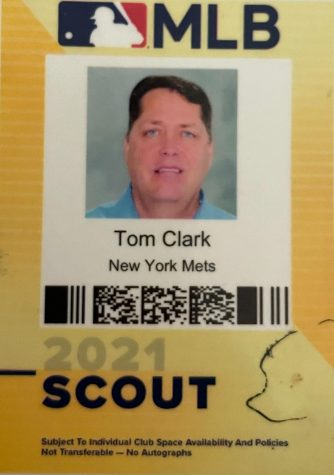 New York Mets scout Clark uses this pass to enter baseball parks, conventions, and anywhere he needs authorization to evaluate baseball players.