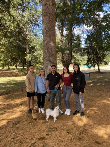 Pictured here is Daphnne Cabrera 23 with her family and two dogs:  Luka and GiGi.