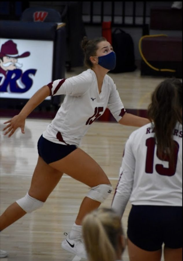 Shannon Clark 23 is in action as she prepares to set the ball.